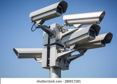 Colour picture of surveillance cameras on blue background