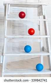 Colour plastic balls on wooden stairs for background.