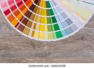 Colour sampler for painting on wooden background