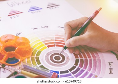 Colour wheel paint with sunset background.