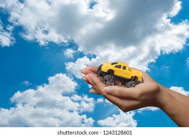 The colour yellow toy car ngonmue women to protect car insurance protection. The concept of waiver of car collisions with posture, prevention and protection of icon, car, concept, new sky