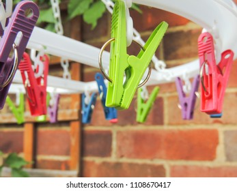 Coloured Clothes Pegs on Washing Line