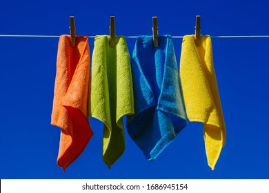 coloured dish cloths drying on the washine line
