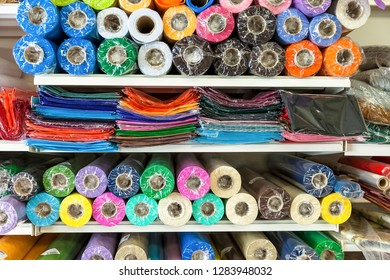 Coloured Fabric  in cellophane wrap on display in shop. Stock Image