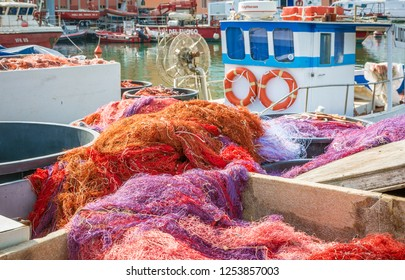 Coloured fishing net in the port of Livorno, Tuscany, Italy.