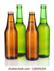 Coloured glass beer bottles isolated on white