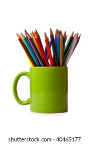 Coloured pencils in a mug against a white background