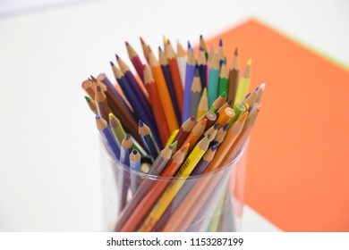 Coloured Pencils on white desk