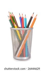 coloured pencils in plastic glass