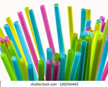 Coloured straws, bundles on a white background