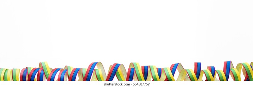 Coloured streamers before white background