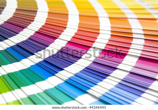 coloured swatches book open showing an array of rainbow colours