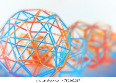 Coloured three-dimensional model of geometric solids closeup defocused - abstract blurred background.
