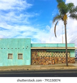 Colourful 1950s building facade in oceanside california  with lone palm tree