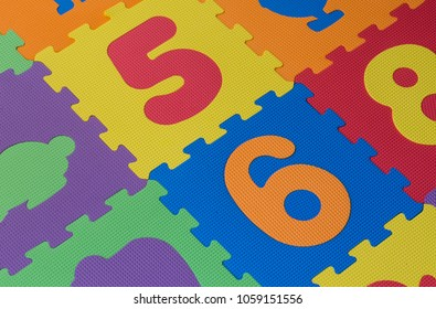 Colourful alphabet puzzle pieces and letter tiles background