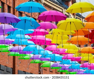 A colourful array of hanging Umbrellas in the city of Durham, UK.