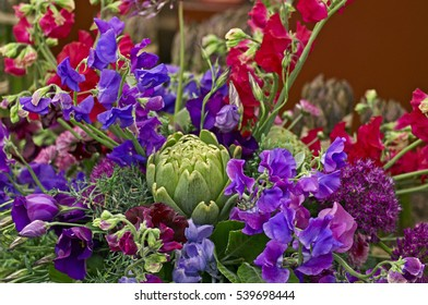 A colourful and attractive modern arrangement of red and purple flowers