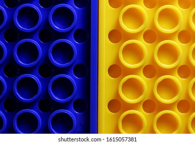 Colourful back of plastic construction. Background, texture. Closeup. Copy space