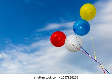 Colourful balloons against a beautiful blue sky