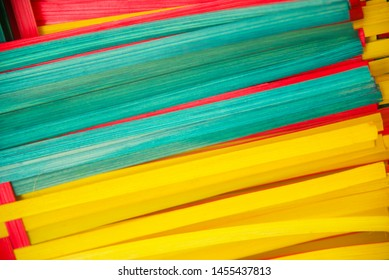 Colourful bamboo objects isolated blurry photo