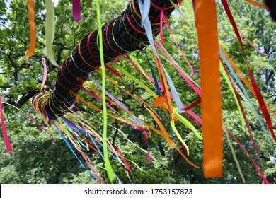 Colourful bands with wishes hanging from a branch