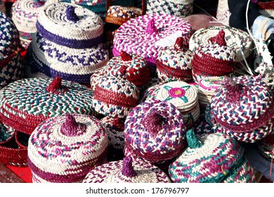 Colourful baskets with lid made of date palm leaves