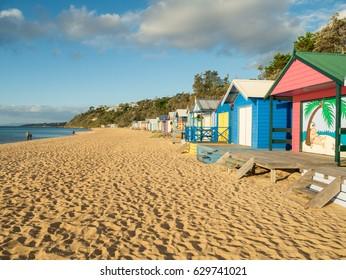 Colourful bathing boxes on Mills Beach in Mornington on the Mornington Peninsula south of Melbourne, Australia.