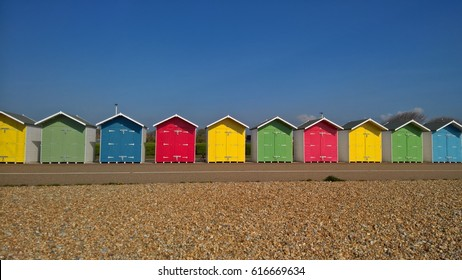 Colourful Beach Huts, Eastbourne, England, UK . Beach holiday scene