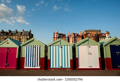 Colourful beach huts on the seafront in Brighton and Hove, England, are rented out and bought by local residents to enjoy on the promenade in Hove.
