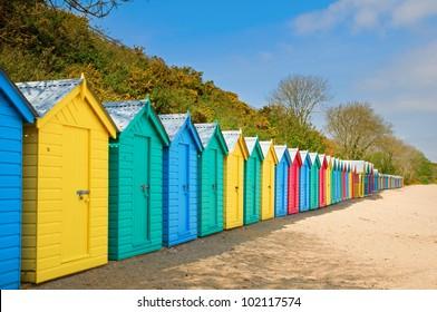 colourful beach huts on sunny beach