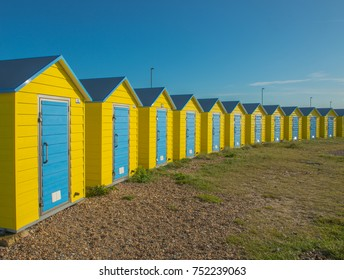 Colourful beach huts, stand out, with the deep blue sky, taken at the seaside town of Littlehampton. England.
