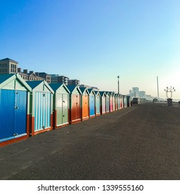 Colourful Beach Huts at sunset in Brighton and Hove, Sussex, England