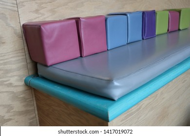 A colourful bench in a play area.
