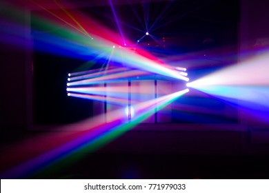 Colourful blurred disco spot lights. Dark composition with stream of light