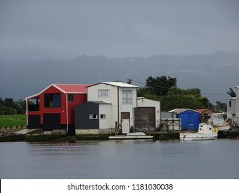 Colourful boat houses on Hutt River mouth, Lower Hutt New Zealand