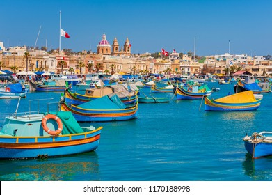 Colourful Boats in Harbour of Marsaxlokk Malta at springtime