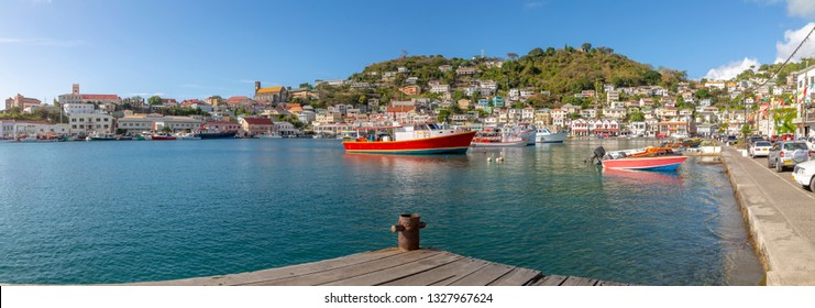 Colourful boats and houses on the Carnarge of St George's, Grenada, Windward Islands, West Indies, Caribbean, Central America 2 February 2019