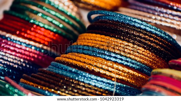 Colourful bracelets isolated fashionable products abstract background photo