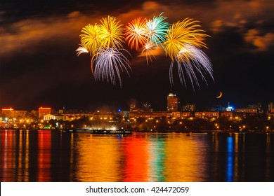 Colourful bright firework on the city, moon and river background