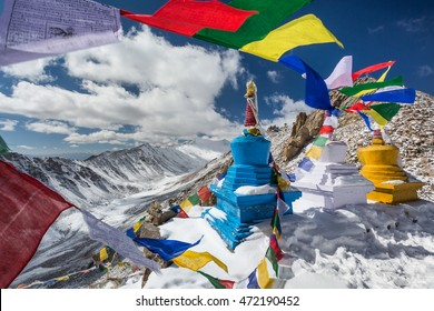Colourful Buddhist religious stupas and prayer flags in late October at Khardung La pass, the highest (5,359 m, 17,582 ft) motorable pass on the world. Ladakh, Jammu and Kashmir, India
