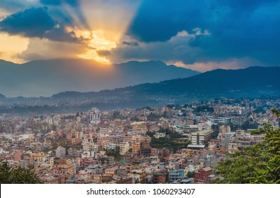 Colourful buildings of Kathmandu , the capital of Nepal. Dramatic Sunset sky with sun beams breaking out the clouds.