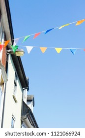 Colourful bunting flags over a street in Bury St Edmunds, UK