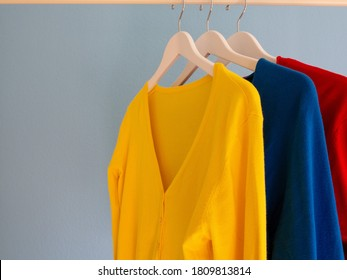 Colourful women's cardigans hanging on a clothes rail