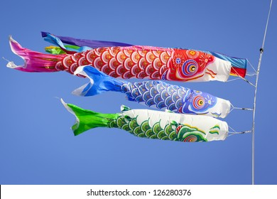 Colourful carp streamers or Koinobori flutter in the wind. The carp shaped wind socks are flown to celebrate Children's Day, a national holiday in Japan.