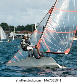 Colourful children sailing activities in all types of small boats and dinghies in fun and competition. Teamwork by junior sailors racing on salt water Lake Macquarie.
