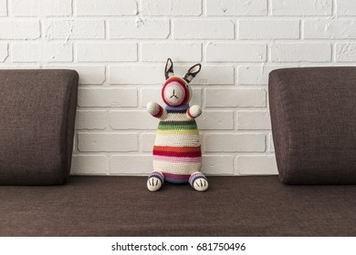 colourful childrens toy crochet bunny on a sofa
