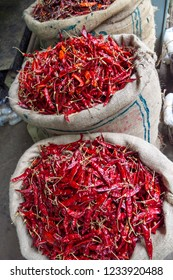 colourful chillis in sacks at the Pettah market, Colombo, Sri Lanka