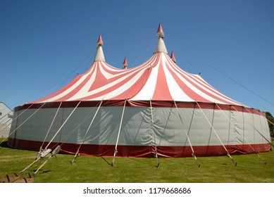 Colourful circus tent against a blue sky