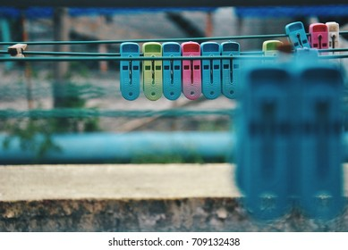 Colourful clothes pegs . Selective focus