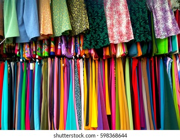 Colourful Clothes in wardrobe